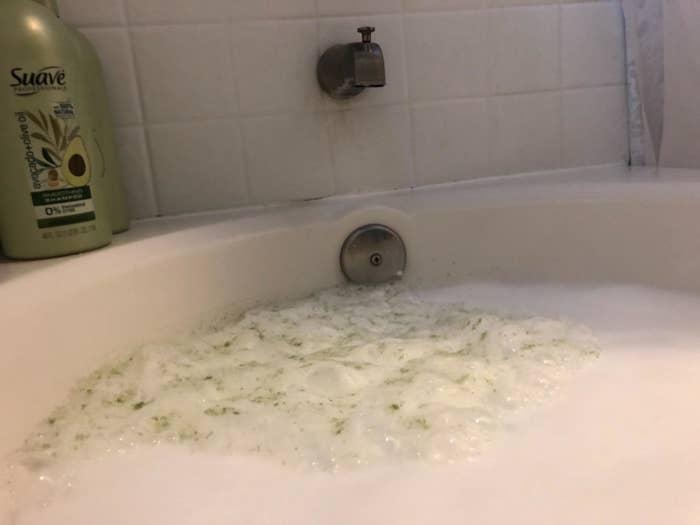 dirty green foam in tub
