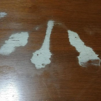wooden table with thick white stains