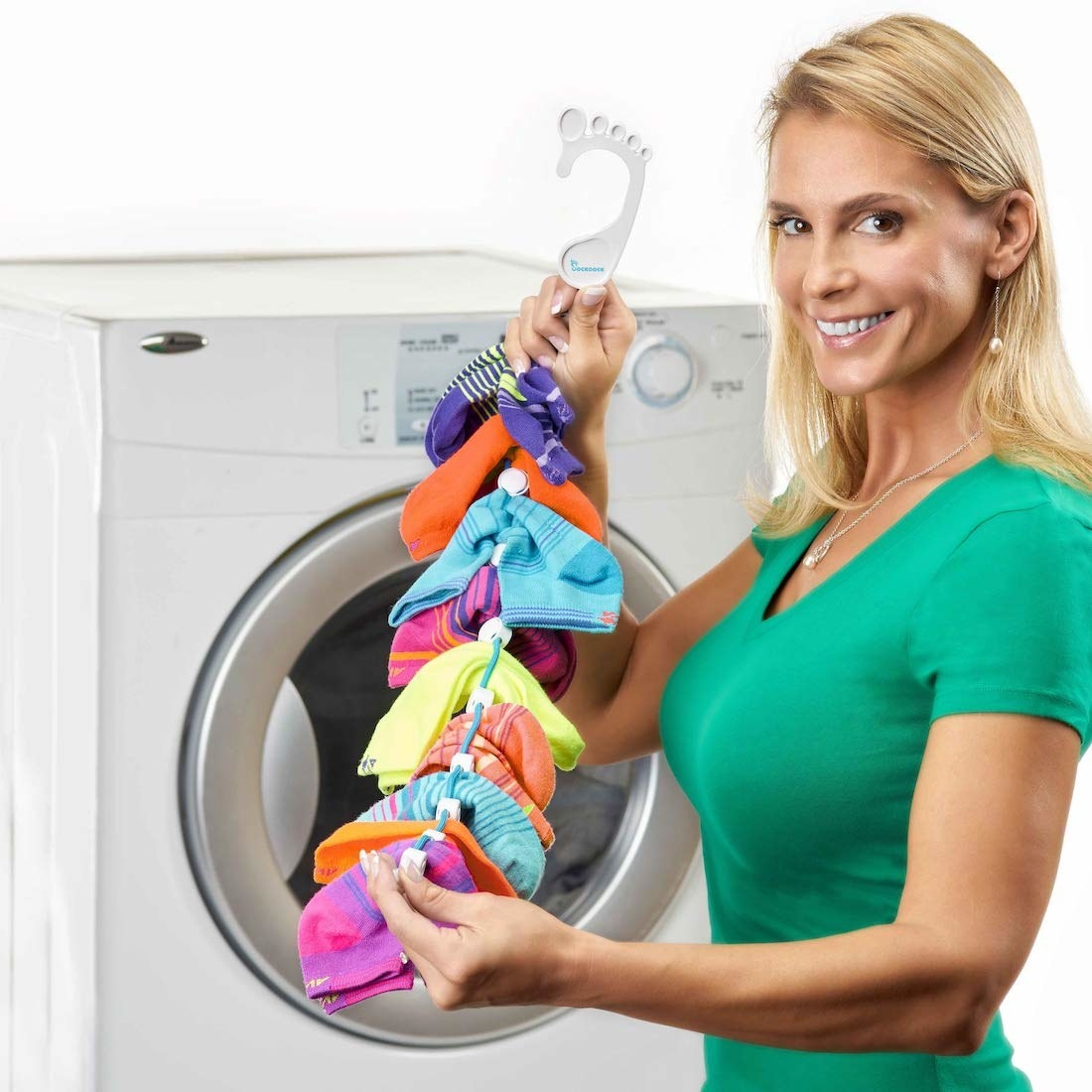 A model holding the sock doc stocked with nine pairs of socks; it's an elastic cord with white dividers creating gaps where you can slip in socks