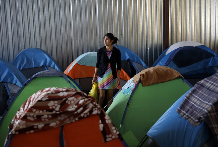 A woman from Guatemala waits at a shelter of mostly Mexican and Central American migrants to begin the process of applying for asylum on April 12 in Tijuana, Mexico.