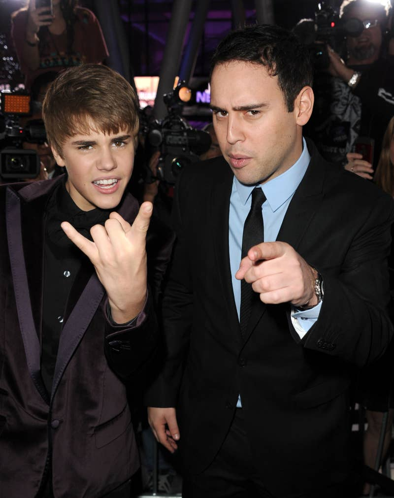 Justin Bieber, left, and manager Scooter Braun at the premiere of the Justin Bieber: Never Say Never Tour in 2011.