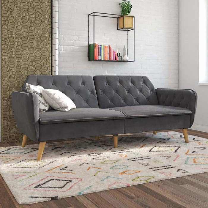 """Promising review: """"Easy to assemble, absolutely stunning sofa. Fabric is so soft and the frame is super sturdy. Memory foam is firm but supportive. Best futon I have ever seen or felt. Really good quality piece."""" —Sonya MeddebGet it from Amazon for $373.99+ (available in three colors, also in a daybed/trundle version)."""