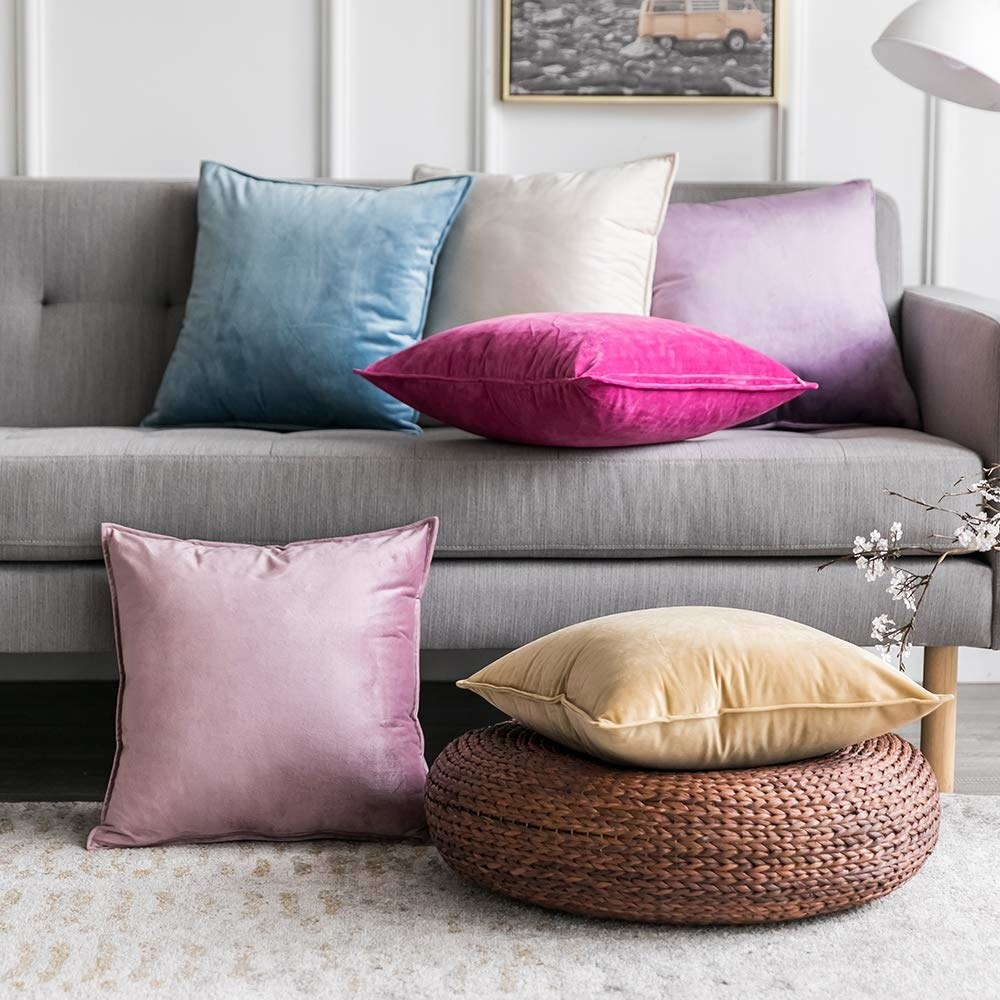 couch with several velvet throw pillows on it