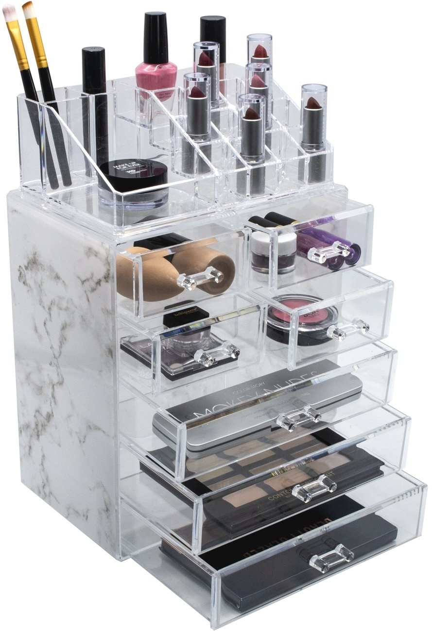 tall makeup storage tower with pullout clear drawers and marble print on the side