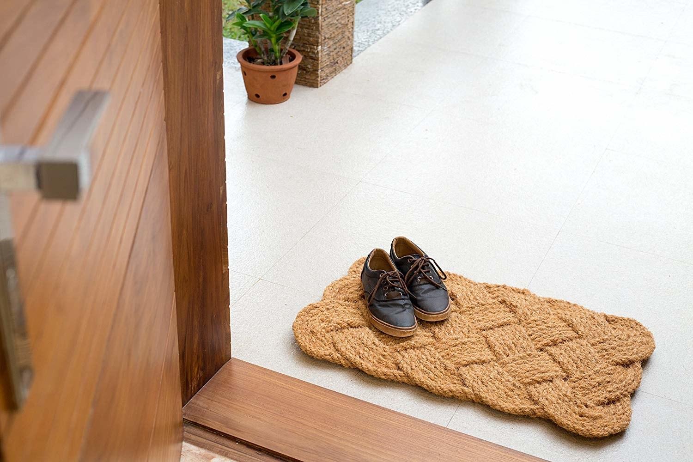 front door with jute braided rug