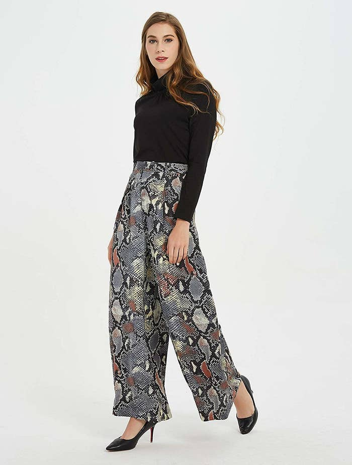 afbdec2986 A pair of snake-print palazzo trousers that ll encourage you to ditch your  overused denim in favor of bottoms that are not only MUCH more relaxed