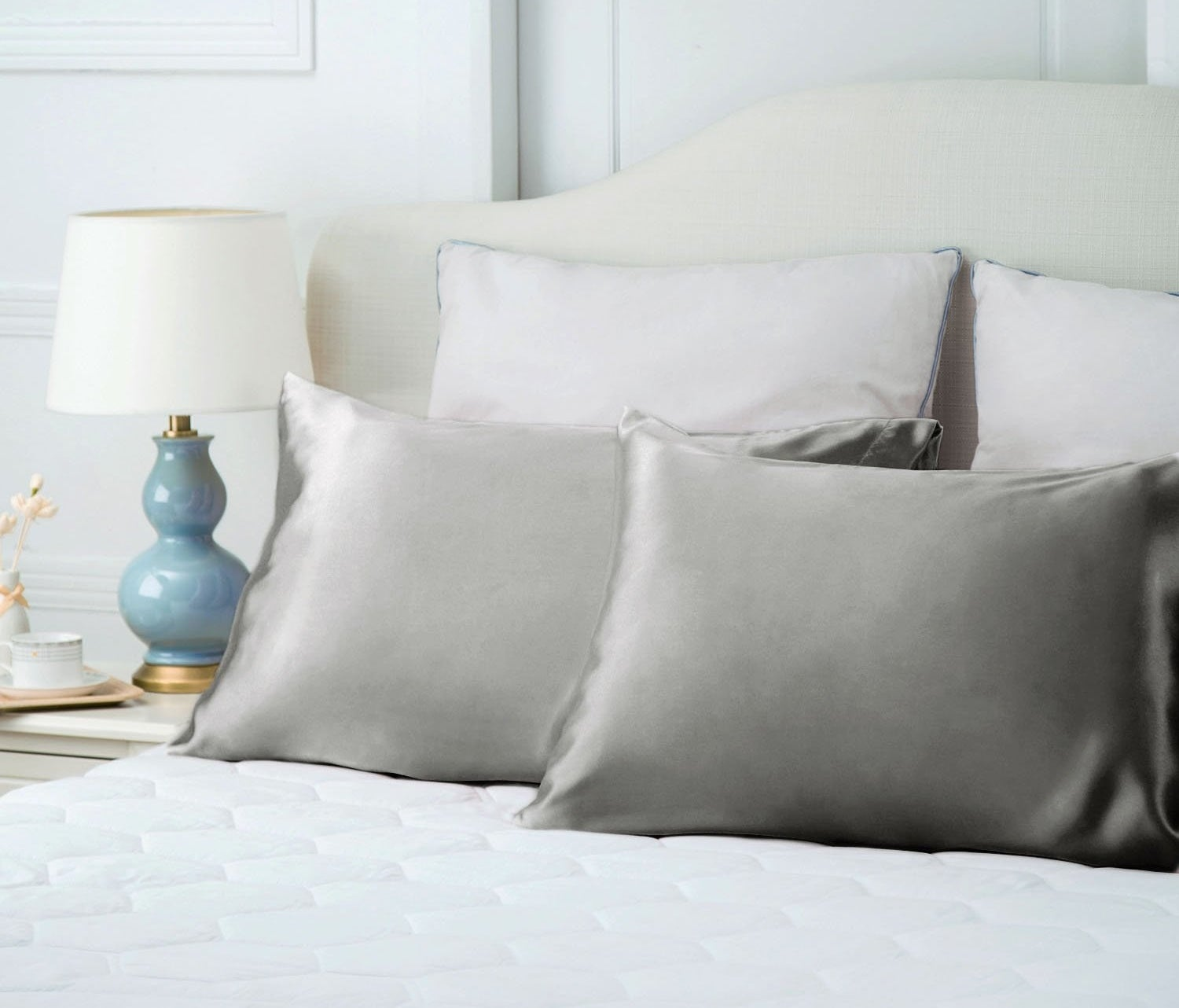 light gray satin pillowcases on a bed