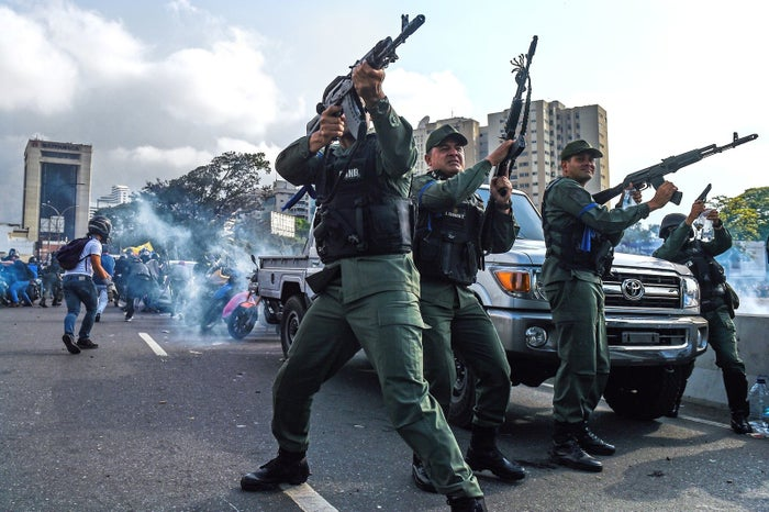 Members of the Bolivarian National Guard who joined Guaidó fire into the air to repel forces loyal to President Nicolás Maduro.