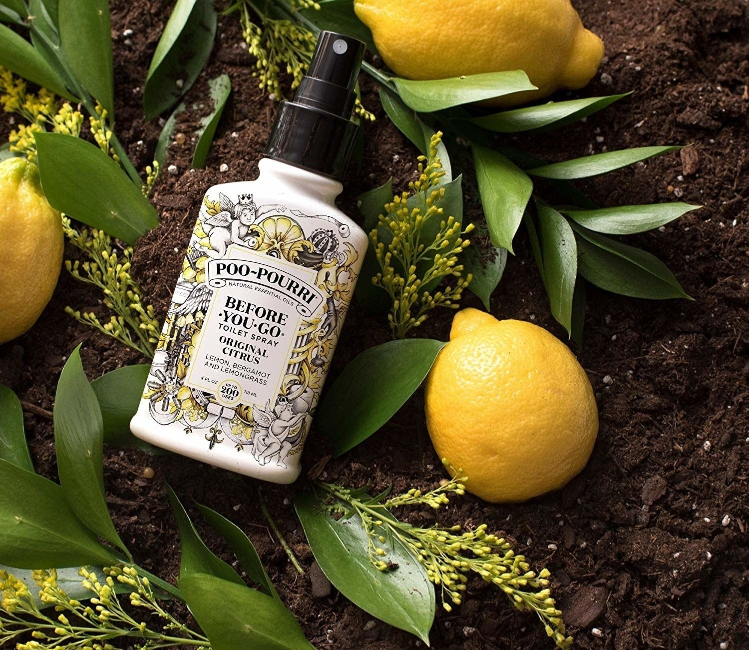 A bottle of the original citrus-scented spray styled with lemons and lemon branches