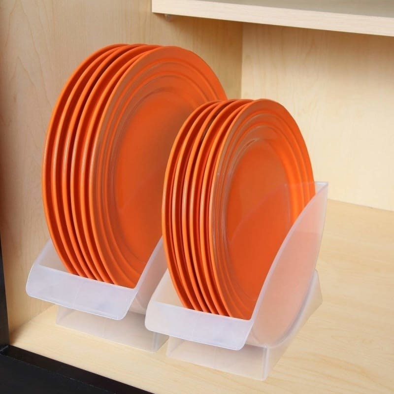 two white opaque holders with plates in them