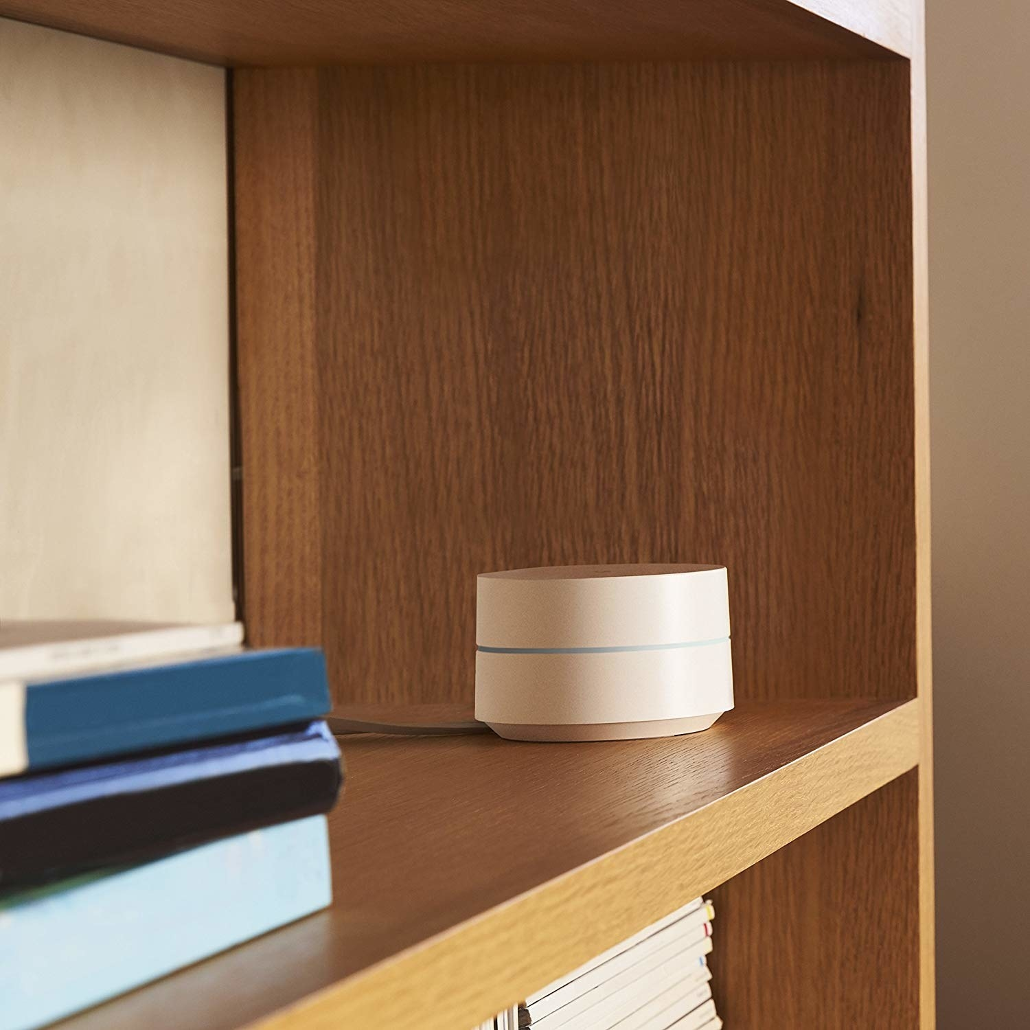 The small white circular system sitting on a shelf