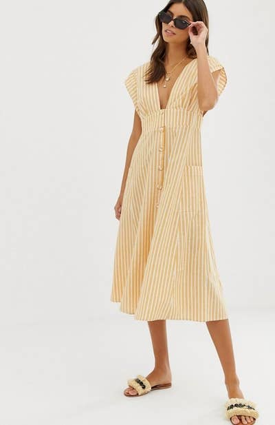 ad98e4d9373 An open back midi dress with a plunge neck and a classic fit for nautical  and preppy vibes. Asos