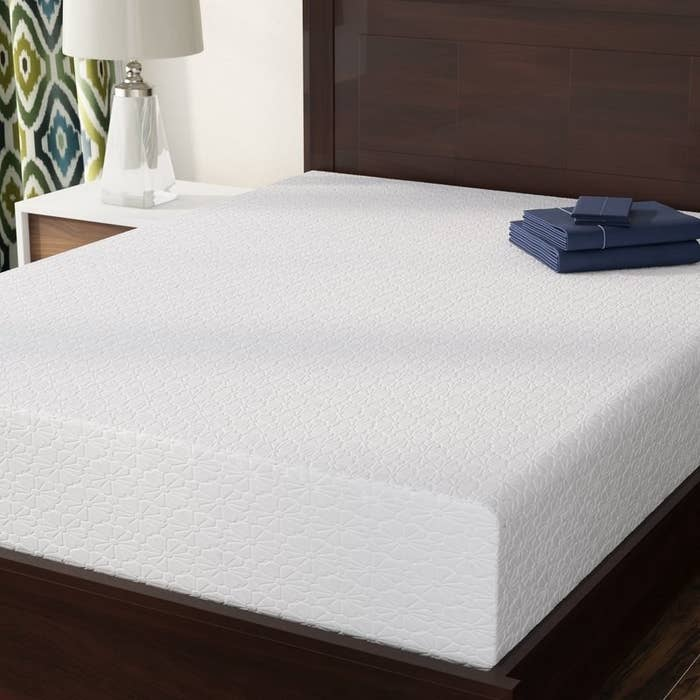 """Promising review: """"My husband and I spent two years looking for mattresses, and the last thing we thought we would ever do is an impulse buy a mattress online without even laying on it. Well, I've never been so happy I took the leap! No more tossing and turning, no more back pain or stiffness. I think he even snores less! I can't feel him get up in the mornings, and most importantly we both get what we need — I like a firm mattress, and he likes a soft one. This bed forms to you. It will give you what you need and never sags, just bounces right back in to place. It was delivered fast and took minutes to open and fully unfold. No chemical smells, no hassle, just a great night sleep."""" —TamiraGet it from Wayfair for $161.99+ (originally $299, available in sizes twin–king)."""