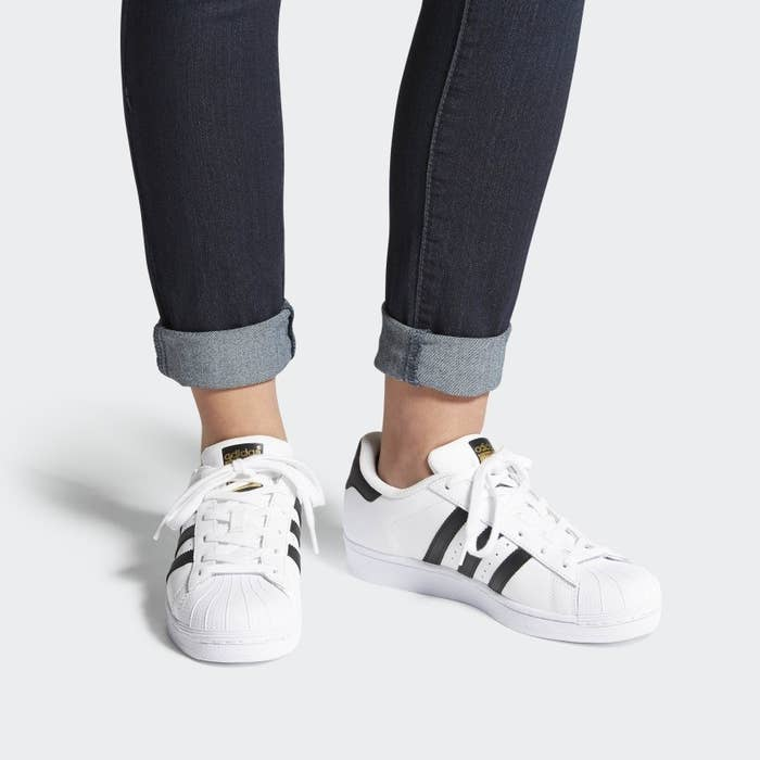 adidas superstar shoes with three black stripes on either side
