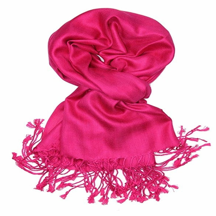 The scarf with fringe on the end in bright pink