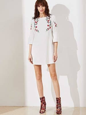 d1635abc69ca An embroidered tunic with bell sleeves that'll give your ensemble a fancy  feel and sweet ~poppy~ of color.
