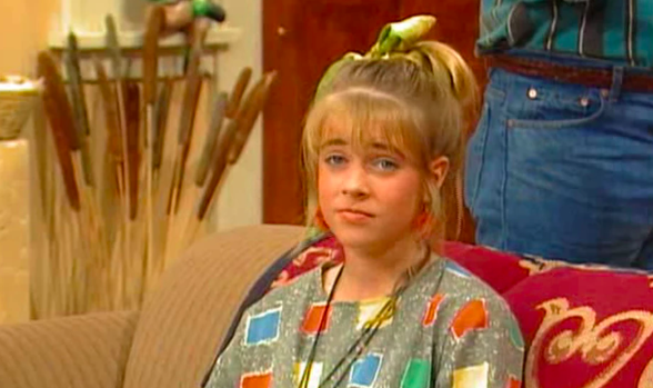 "A screenshot of Melissa as Clarissa on ""Clarissa Explains It All"""