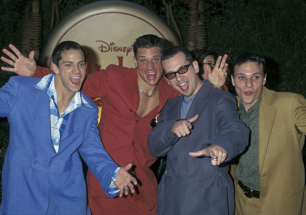 98 Degrees making faces on the red carpet at the premiere of Mulan in 1998