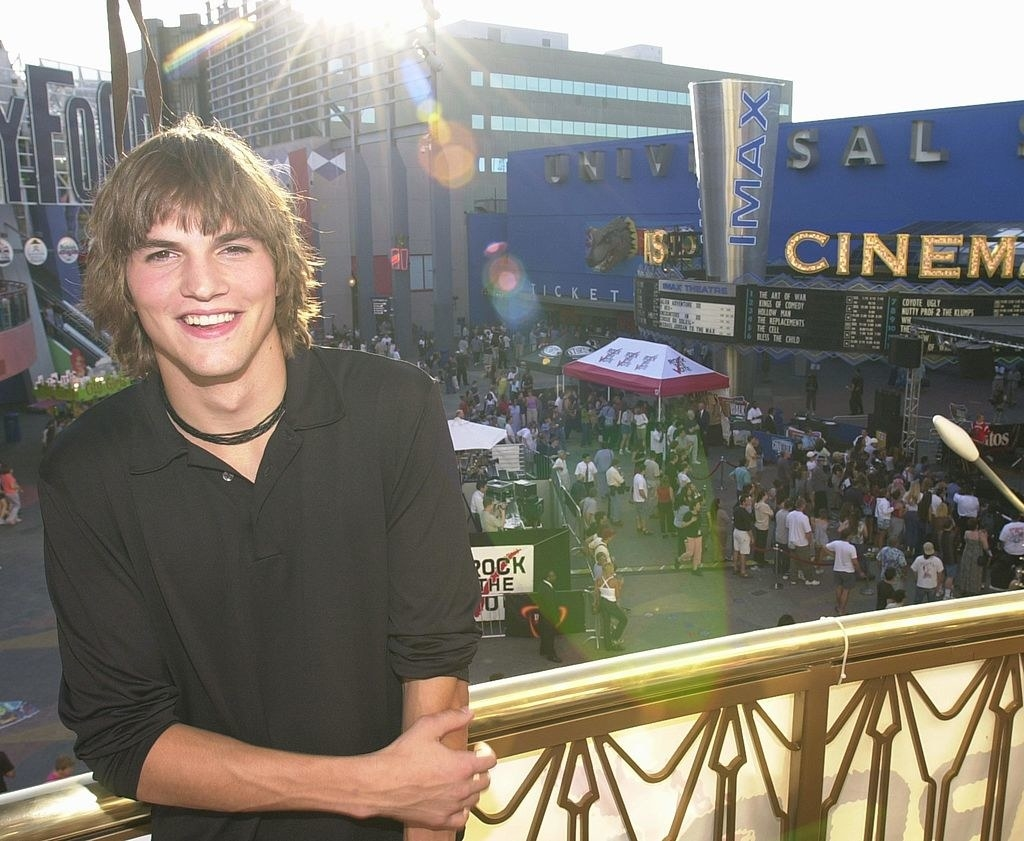 Ashton Kutcher standing on the balcony of building at City Walk in California