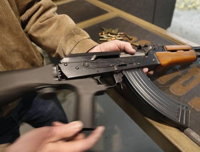 A bump stock is installed on an AK-47.