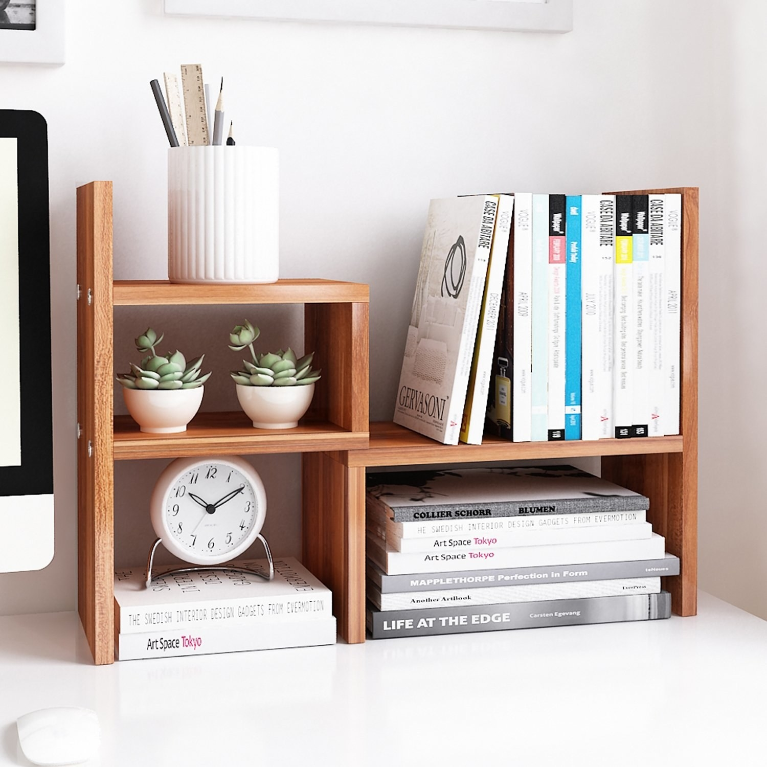 wooden desk organize with shelf compartments on a desk surface