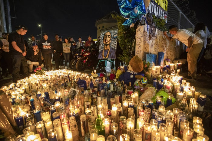 People mourn for rapper Nipsey Hussle on April 1, in Los Angeles. The Grammy-nominated artist was gunned down in broad daylight on the day he was scheduled to meet with Los Angeles Police Department brass to discuss ways of stopping gang violence.