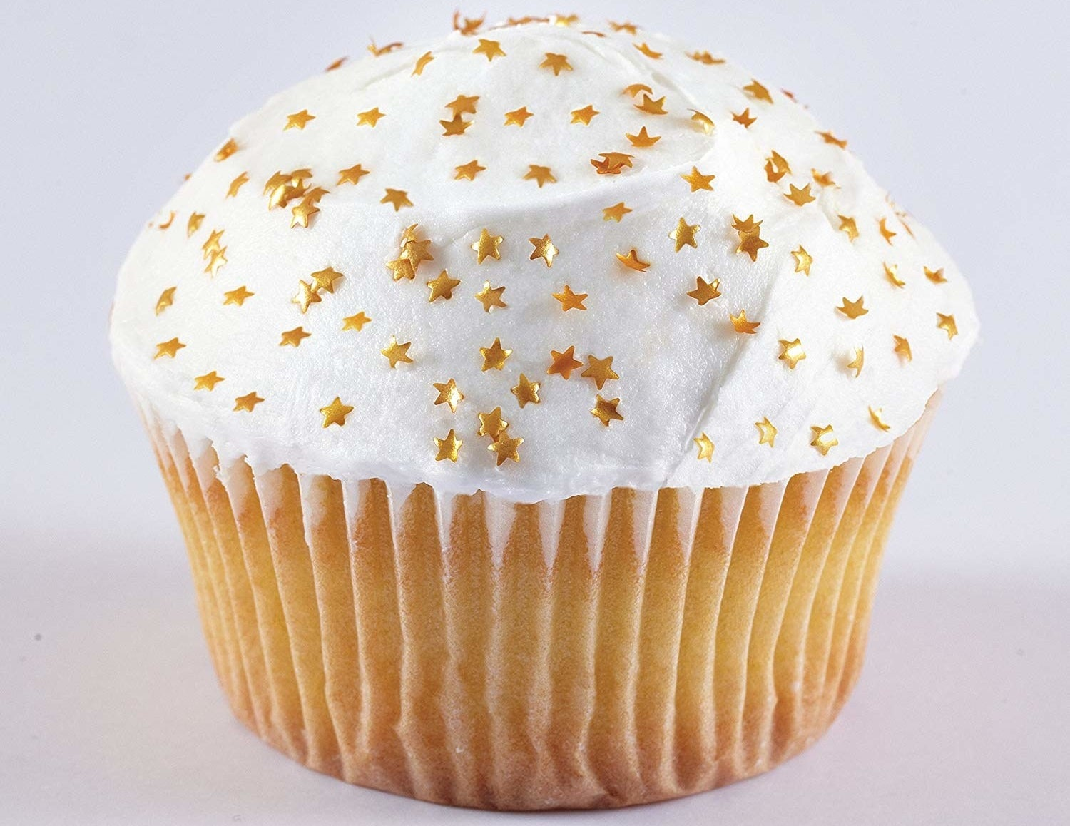 The edible gold stars on top of a cupcake