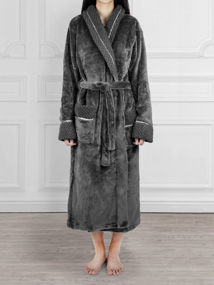"""Promising review: """"This is quite possibly one of the best purchases of my life. Somehow I have gained a confidence to rule a country while in this robe. It is so comfortable and soft! It is nice and long too, and has the most amazing pockets. Great for anyone who appreciates being cozy around the house."""" —MiadoraPrice: $29.99 (available in sizes S–XL and 14 colors)"""