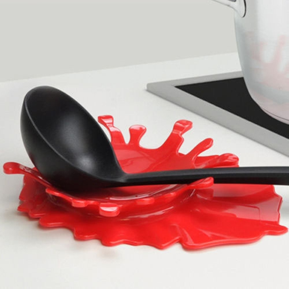 red splash shaped spoon rest