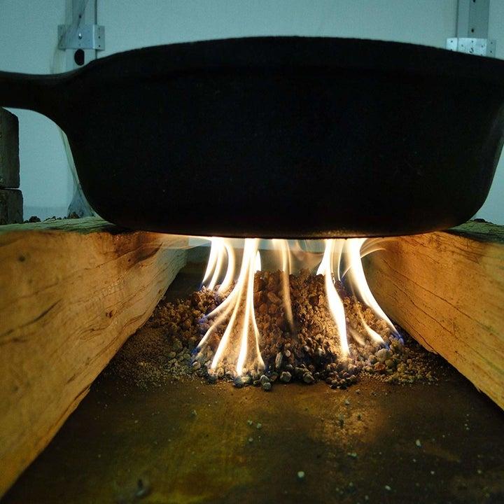 cast iron pan over an outdoor fire