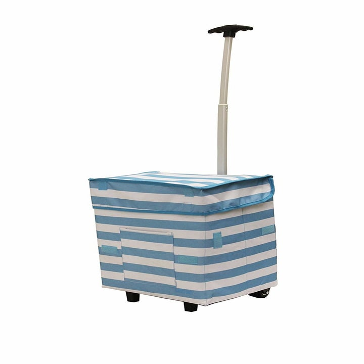 square shaped shopping bag with a front pocket on wheels with a long handle for pulling