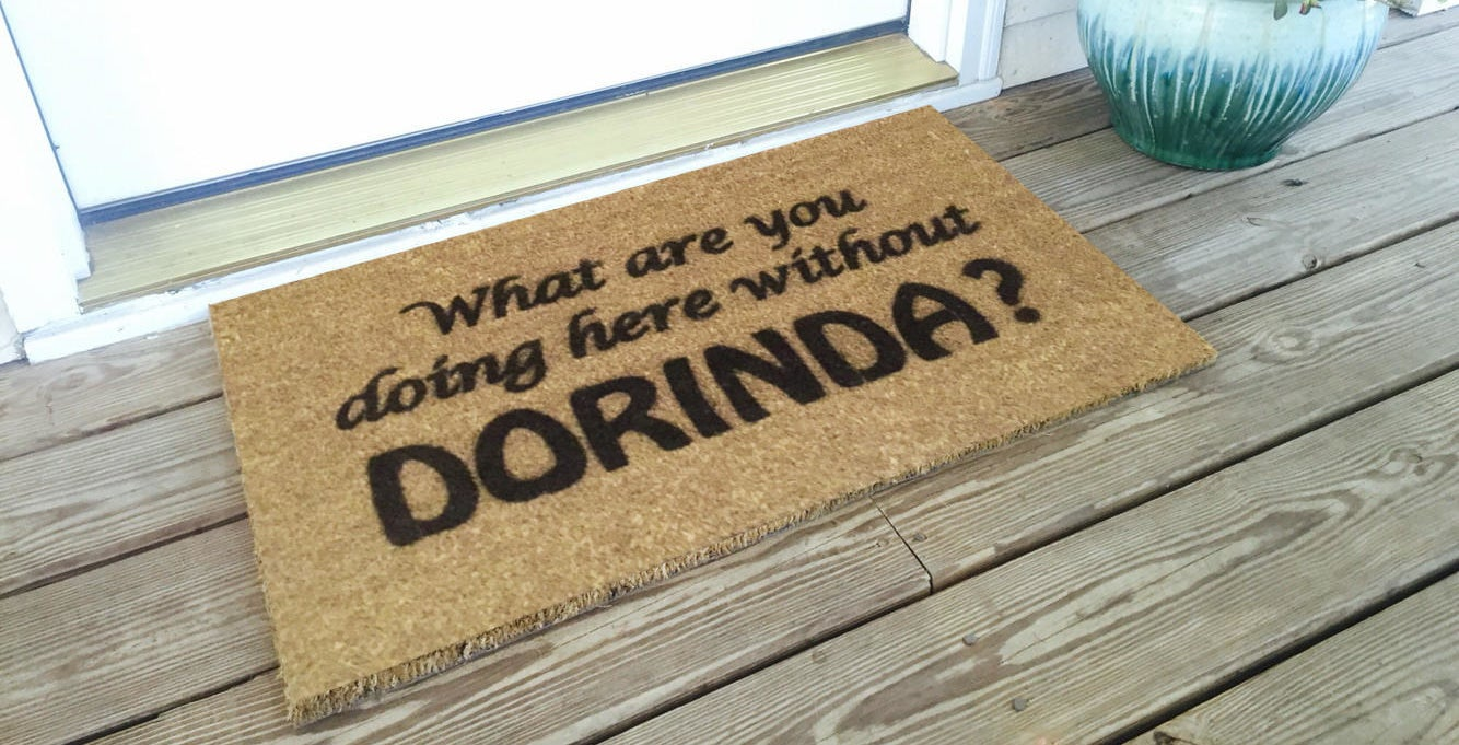 """a door mat that says """"what are you doing here without dorinda?"""""""