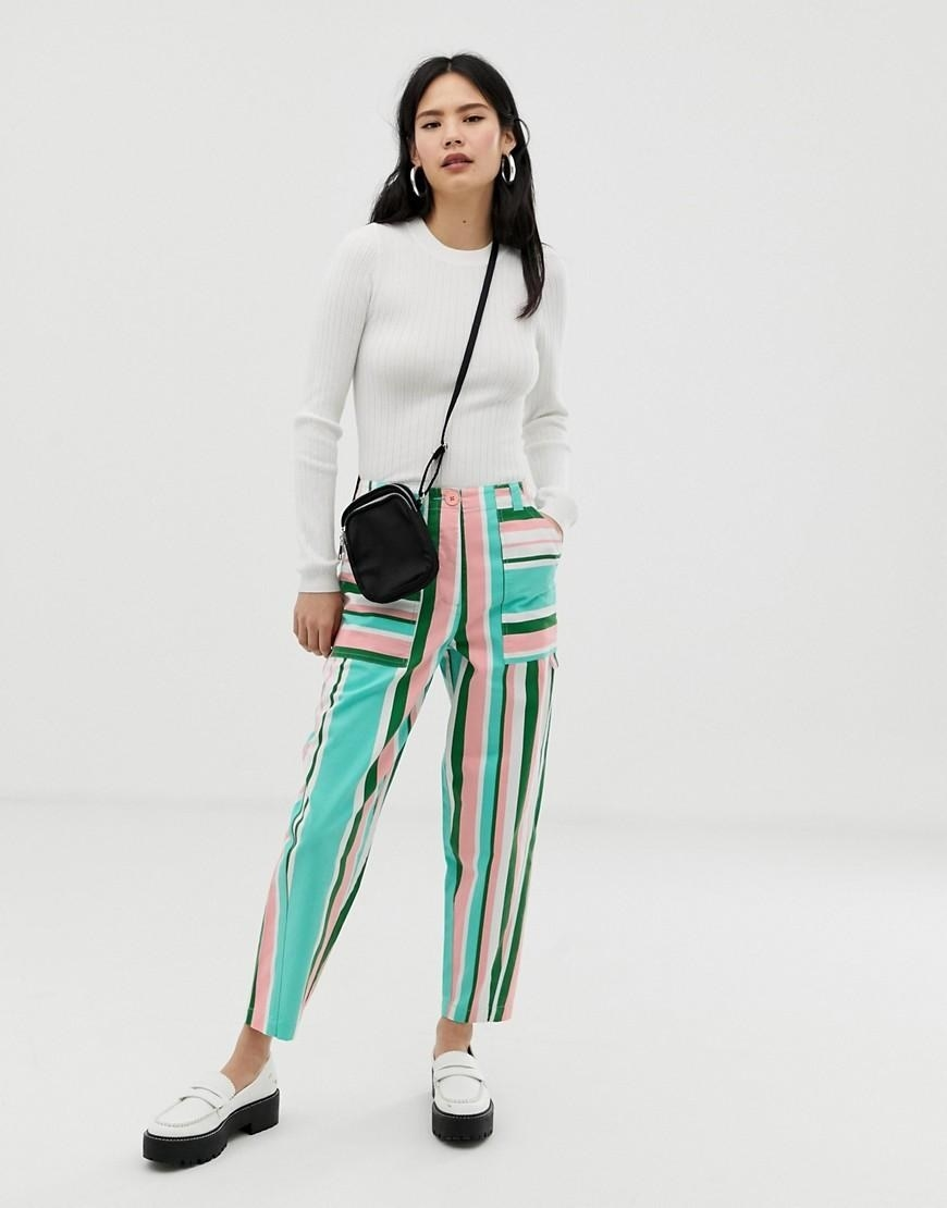 2cdf37a9697 A pair of multicolored peg pants because spring is here and you need to  show off your collection of pastels wisely. Asos