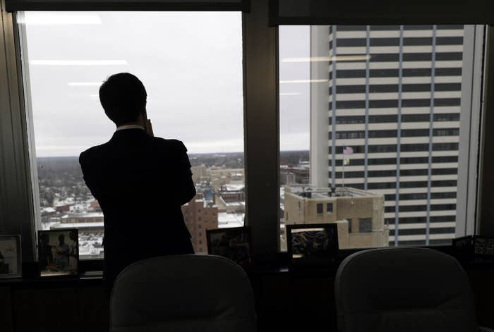 Mayor Pete Buttigieg looks out the window of his South Bend office on Jan. 10.