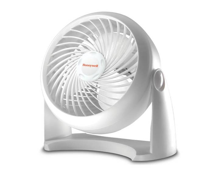 the white Honeywell plastic fan on a base that allows it to be adjusted to face up, forward, down, and in-beween