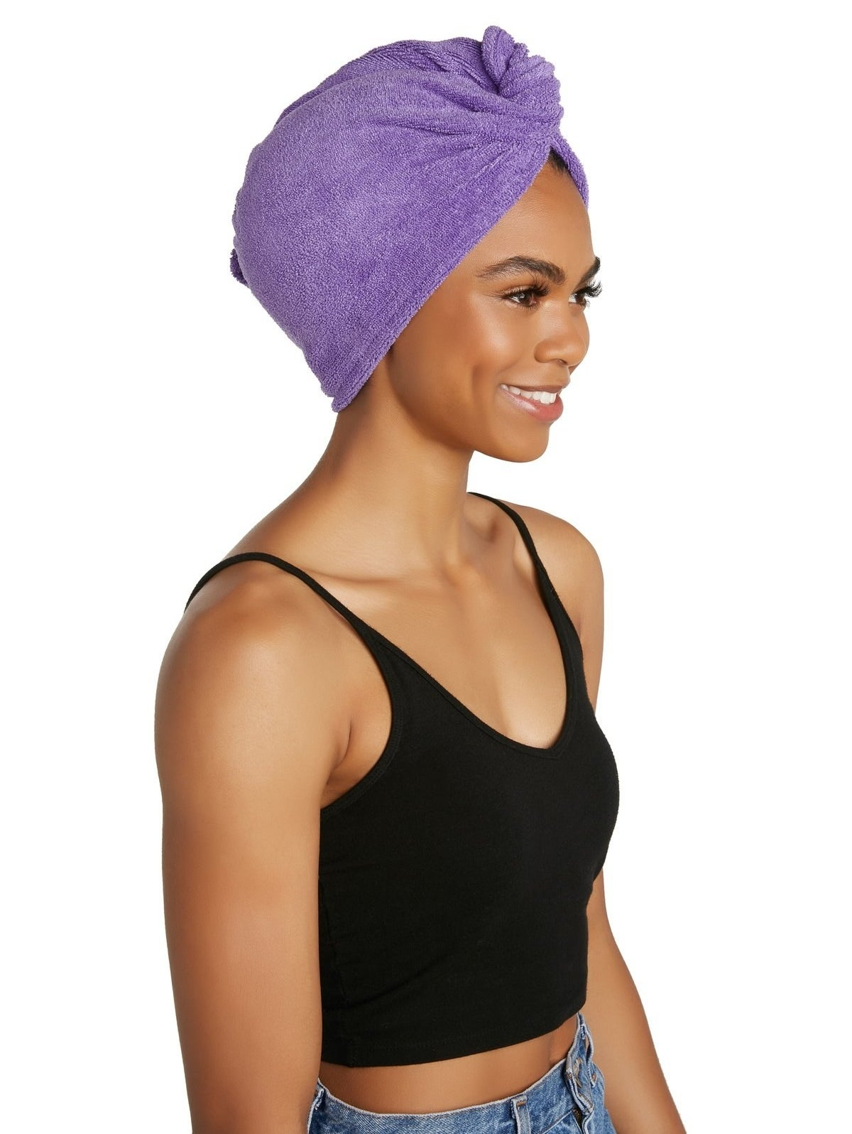 person wearing the turbie twist on head while wearing clothes