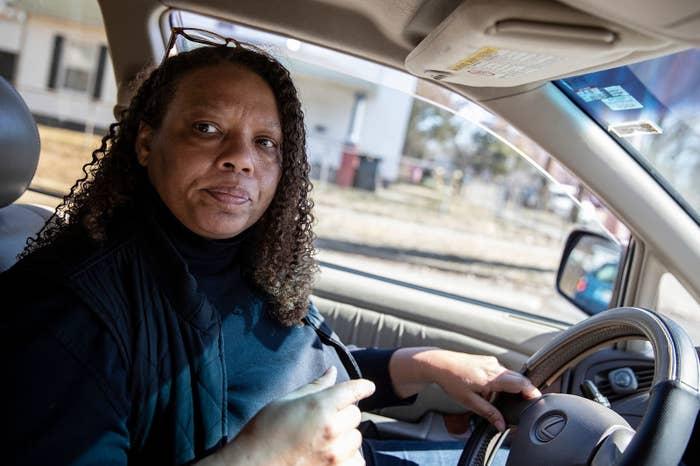 Regina Williams-Preston drives through her neighborhood on March 12.