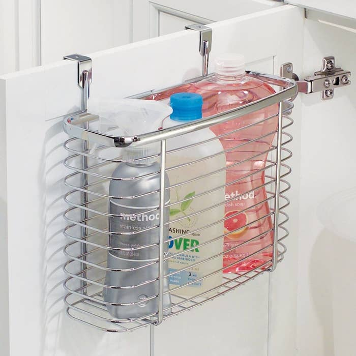"""Promising review: """"This over-the-cabinet bin is a convenient way to free up space in a crowded cabinet."""" —Tousson Price:$11.99"""