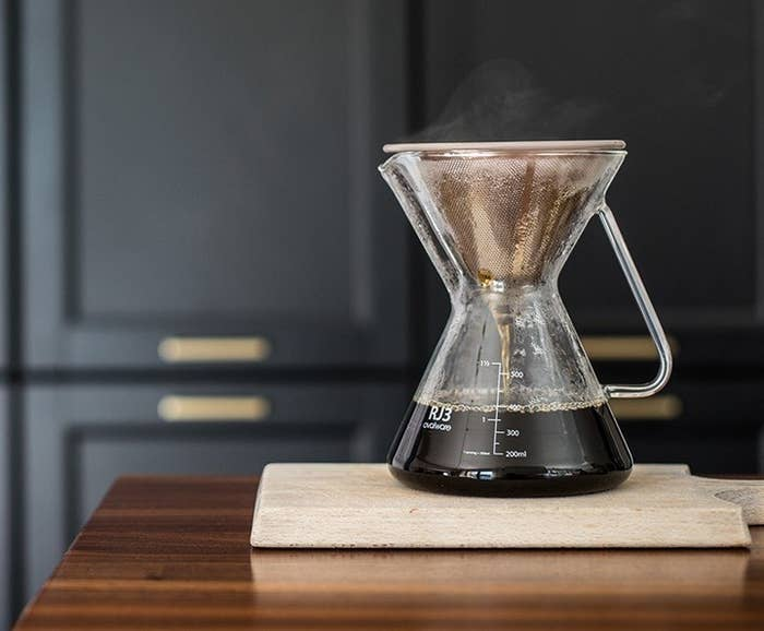 glass pour over coffeemaker being used with the stainless steel coffee filter