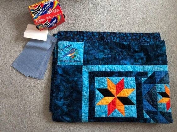 reviewer photo showing a dyed quilt next to the Shout color catchers