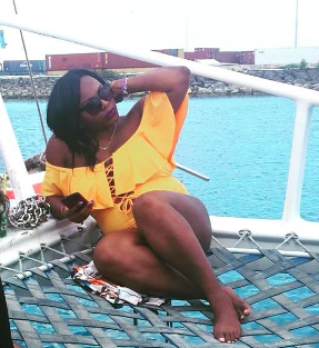 another reviewer lounging in the bathing suit in yellow