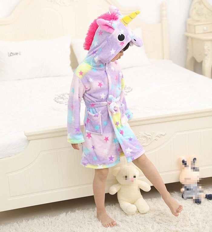 """Promising review: """"I bought this for my almost 3-year-old daughter. I bought it a size up so it is a little large but that's what I expected. She absolutely loves it! The quality is very nice, it washes well and the colors are very nice and bright. The unicorn head hood is really adorable and I like that the robe has pockets. I am 100% pleased with this product."""" —S.LopezPrice: $13.49 (available for ages 0–11 years and 13 colors/styles)"""