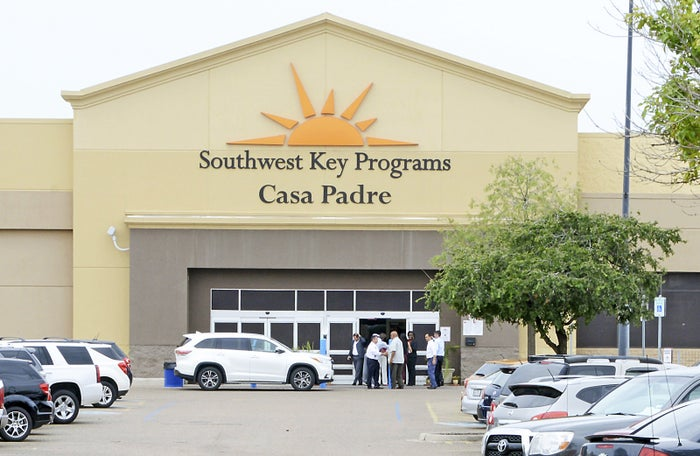 In this June 18, 2018, photo, officials tour Southwest Key Programs Casa Padre, a US immigration facility in Brownsville, Texas, where children are detained.
