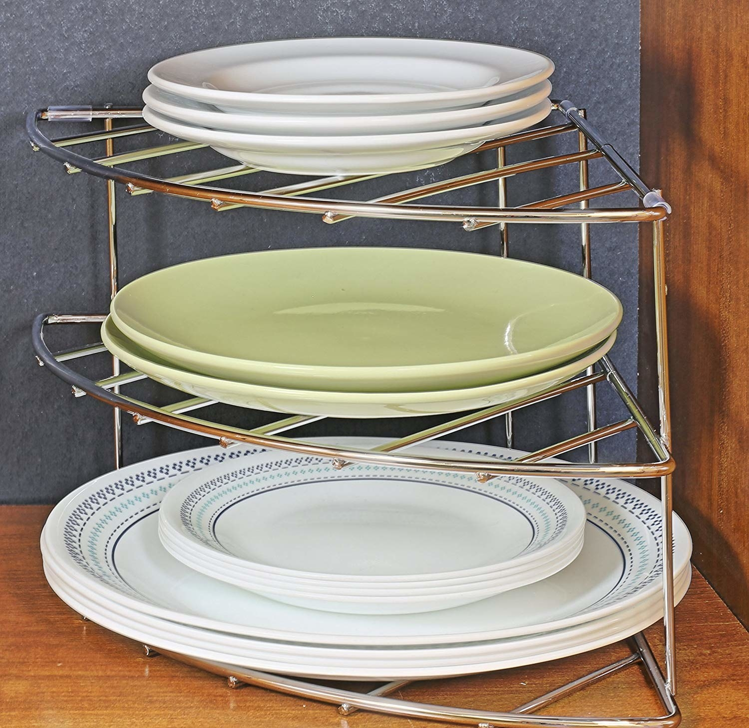 Three-tier silver metal organizer with different sized plates on each shelf