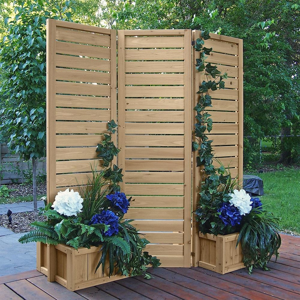 three panel wood privacy screen with planters for flowers at the bottom