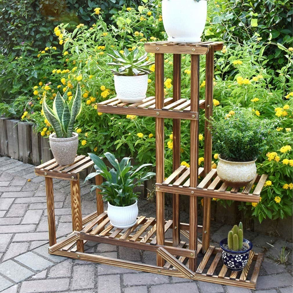 plant stand with various levels of shelves to hold potted plants