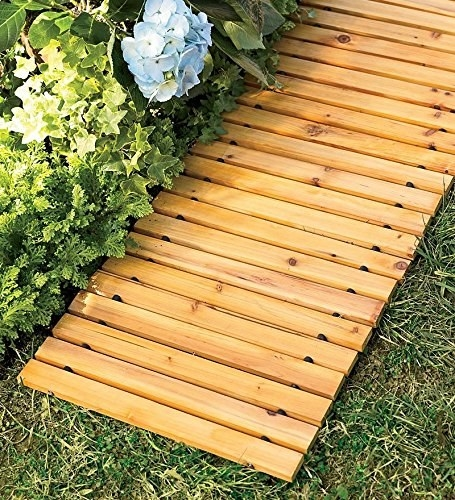 slotted wood walkway beside a bed of hydrangeas