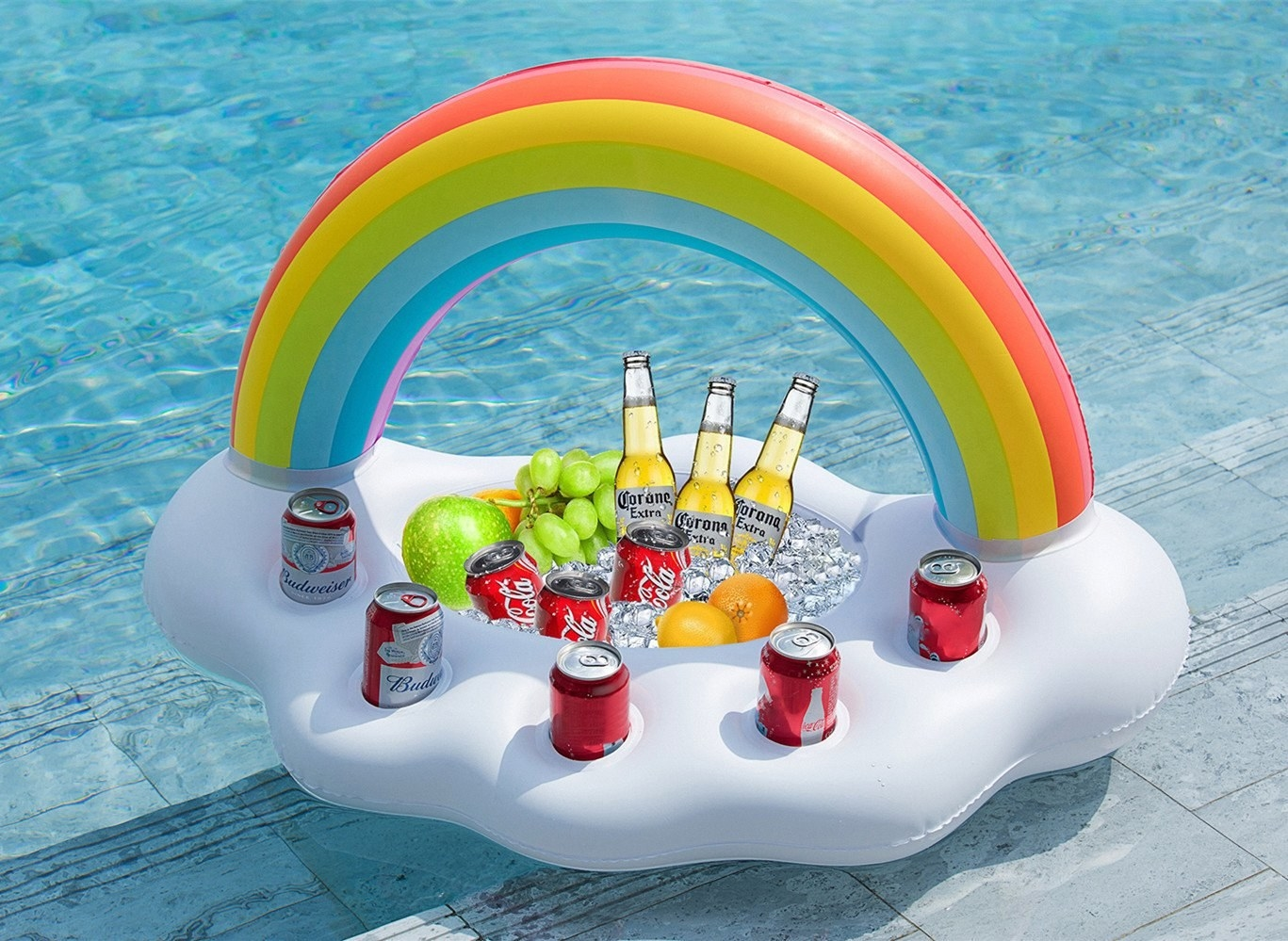 The float, which has a rainbow arch and a cloud base with a large basin which is filled with ice, fruit and drinks, plus five cupholders with cans in them