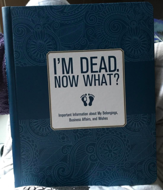 A reviewer photo of the I'm Dead, Now What? book cover.