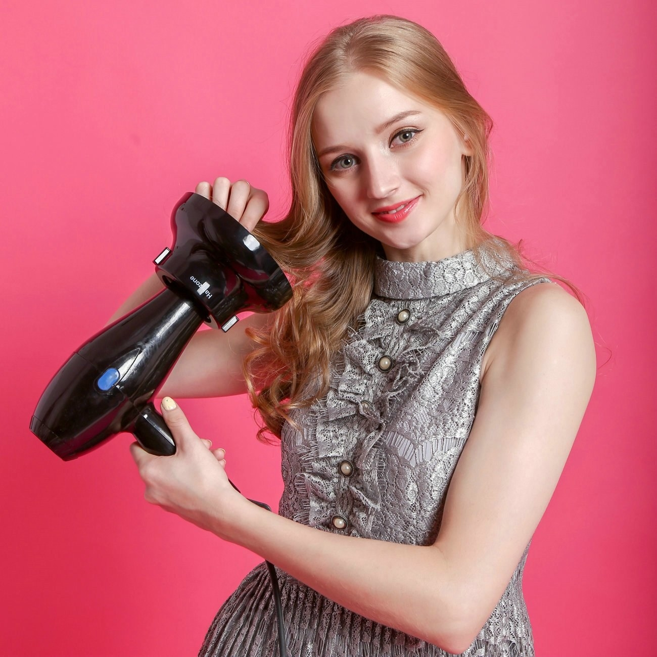 model uses hair dryer with device added to the end